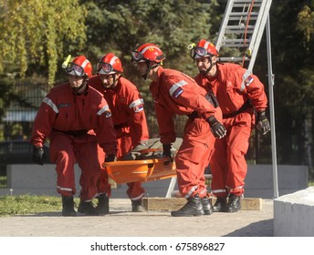 BELGRADE, SERBIA - CIRCA NOVEMBER 2013: Rescue workers carry injured man at safety drill, circa November 2013 in Belgrade