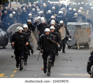 "BELGRADE, SERBIA - CIRCA OCTOBER 2010: Special force policemans runs during street riots at ""Belgrade Pride"" circa October 2010 in Belgrade"
