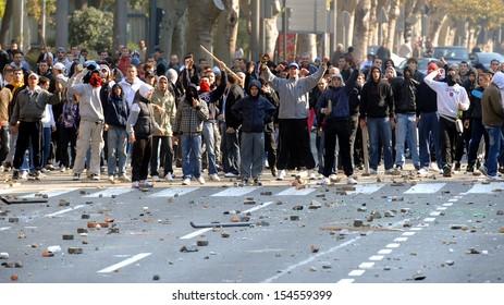 "BELGRADE, SERBIA - CIRCA OCTOBER 2010: Protesters trows stones toward police during street riots at ""Belgrade Pride"" circa October 2010 in Belgrade"