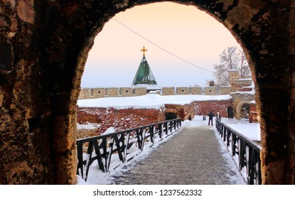 Belgrade, Serbia. Cityscape with snowfall in Kalemegdan fortress and castle completely covered by snow in winter blizzard with people walking under medieval gate.