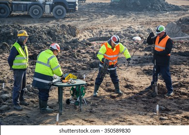 BELGRADE, SERBIA - DECEMBER 12, 2015: Engineers and soil technicians driling for detection of magnetic anomalies with borhole detection. Site investigations for the Belgrade Waterfront project.