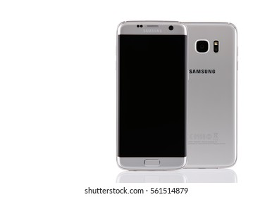 Belgrade, Serbia - December 19, 2016: New silver Samsung Galaxy S7 Edge smartphone,  front and back sides isolated on white background.