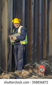BELGRADE, SERBIA - DECEMBER 21, 2015: Welder worker posing, welder with protective gear at work. Selective focus.