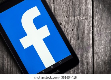 BELGRADE, SERBIA - FEB 25 2016 : Facebook logo on tablet screen. Facebook is largest and most popular social networking site in the world