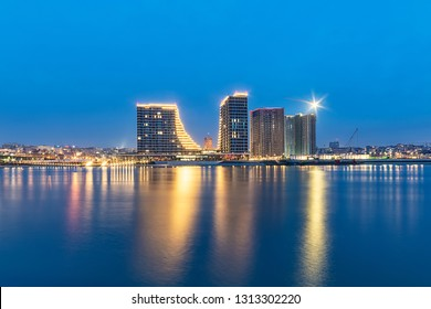 Belgrade, Serbia - February 10, 2019: Belgrade waterfront on the Sava River. Panorama of Belgrade by night with reflection.