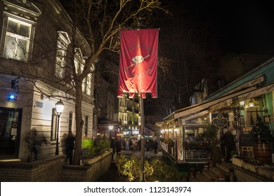 BELGRADE, SERBIA - FEBRUARY 14, 2015: Skadarlija street (also known as Skadarska) at night with its typical cobblestone pavement cafes and restaurants and tourists passing by