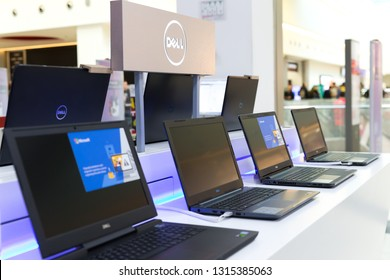 Belgrade, Serbia - February 15, 2019: New Dell laptop computers are displayed on white table in electronic store. Close up shot.