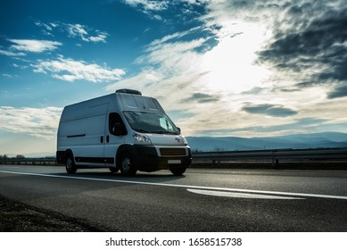 Belgrade, Serbia - February 21, 2020. Ambulance van transporting a patient driving through highway on bright sunny sunset. Medical Transportation vehicle