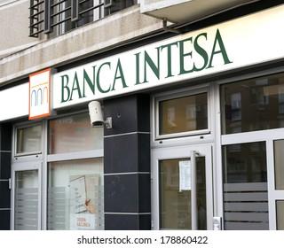 BELGRADE, SERBIA - FEBRUARY 26, 2014: Illuminated sign of Banca Intesa on wall