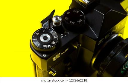 BELGRADE, SERBIA ,JANUARY 02 2019: Retro 35mm film camera isolated on yellow background. Vintage film camera close up. Analog photography background. Zenit 12xp