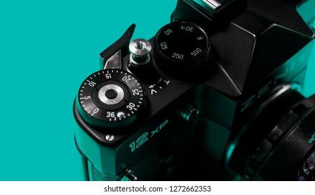 BELGRADE, SERBIA ,JANUARY 02 2019: Retro 35mm film camera isolated on teal background. Vintage film camera close up. Analog photography background. Zenit 12xp