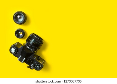 BELGRADE, SERBIA , JANUARY 02 2019: Top view of vintage 35mm film camera on yellow background. Retro camera from above on yellow background. vintage camera lens.