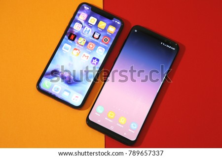 BELGRADE ,SERBIA - JANUARY 08, 2018: Newest Smartphones Iphone X and Samsung Galaxy S8 Plus as a comparison of the device,