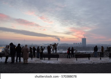 BELGRADE, SERBIA - JANUARY 1, 2015: people taking pictures of New Belgrade (Novi Beograd) from Kalemegdan fortress