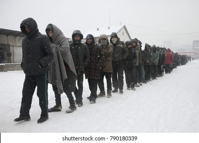 Belgrade, Serbia - January 11, 2017: Migrants waiting in line for food distribution. Around 2000 migrants, mostly men from Afghanistan and Pakistan spent the freezing winter in abandoned warehouses.