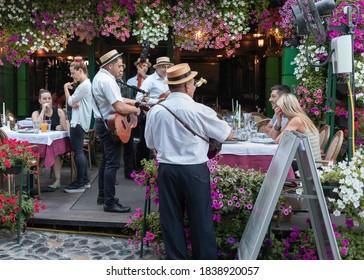 Belgrade, Serbia Jul 5, 2019: Musicians performing at one of the street restaurant terraces in touristic Skadarska Street also known as Skadarlija