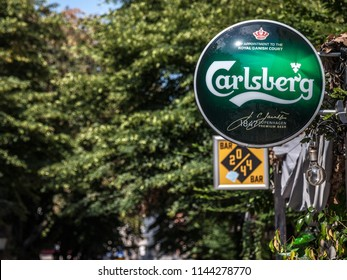 BELGRADE, SERBIA - JULY 11, 2018: Logo of Carlsberg on a bar sign with its distinctive visual. Carlsberg is a Danish light pilsner beer produced in Copenhagen, and a global brewer