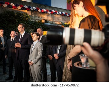 BELGRADE, SERBIA - JULY 14, 2018: Aleksandar Vucic, President of Serbia, and Ana brnabic, prime minister, standing at the French embassy facing a group of journalists with their cameras