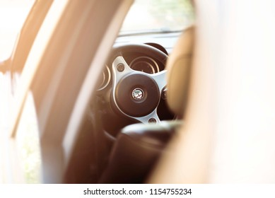 BELGRADE, SERBIA, JULY 17 2018: Alfa romeo 159 car interior. Car steering wheel isolated. Luxury car interior.