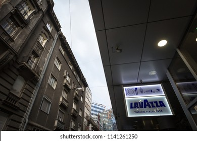 BELGRADE, SERBIA - JULY, 19, 2018: Lavazza Caffe logo lit on a cafe bar of Belgrade, during the evening. Lavazza is one of the biggest coffee producers of Italy, exporting worldwide
