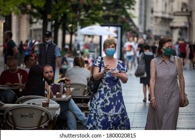 BELGRADE, SERBIA - JULY 29, 2020: Two old Women, white caucasian females, walking wearing face mask respiration protective equipement on Coronavirus Covid 19 crisis.