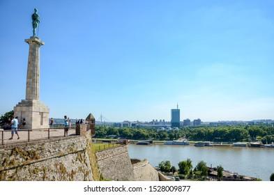 BELGRADE, SERBIA, JULY 4, 2014: People watching view from Belgrade Castle terrace, Pobednik (Victor) monument can be seen on the left side, famous landmark of Belgrade, Serbia.