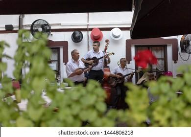 Belgrade, Serbia July 5th 2019: Musicians performing at a restaurant named Three Hats in touristic Skadarska Street also known as Skadarlija