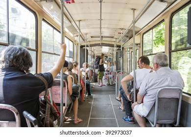 "BELGRADE, SERBIA, JULY 6, 2014: People travelling with the bus, the public city transport in Belgrade is performed by GSP ""Beograd"" (buses, trolleys, trams)."