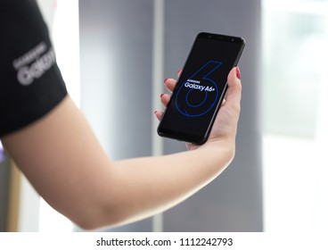 Belgrade, Serbia - Jun 01, 2018: Newly launched Samsung Galaxy A6 Plus Smartphone is displayed with A6+ logo home screen