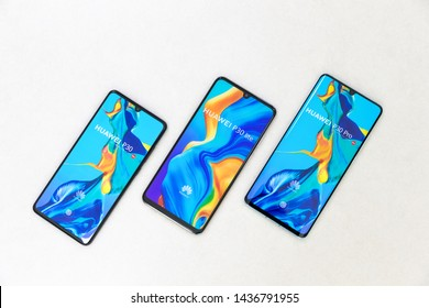 Belgrade, Serbia - Jun 27, 2019: Three new Huawei P30, P30 Lite and P30 Pro mobile smartphones are displayed on isolated white background.