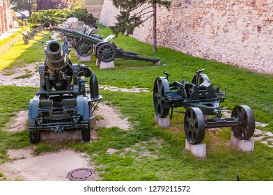 Belgrade, Serbia - June 09, 2013: Artillery guns and weapons stand on stone foundations as part of outdoor exposition of various artillery weapons on territory of Belgrade fortress.