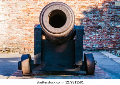 Belgrade, Serbia - June 09, 2013: Huge medieval howitzer gun on stone floor as part of outdoor exposition of various artillery weapons on territory of Belgrade fortress.