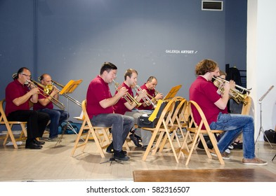 BELGRADE, SERBIA - JUNE 14 2016: Several Musicians from Army Band dressed as civilians and sitting are playing traditional song for Audiance