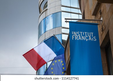 BELGRADE, SERBIA - JUNE 14, 2018: Logo of the French Institute (Institut Francais) with the French flag on their HQ for Serbia. Institut Francais is in charge of promoting French language and culture