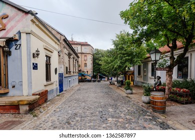 Belgrade, Serbia - June 16, 2018. Historic place Skadarlija with shops, galleries, cafes, trees, cobbled lanes and alleys in downtown. Bohemian street with bars, cafes and graffiti.
