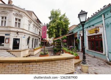 Belgrade, Serbia - June 16, 2018. Historic place Skadarlija with bakery, lamppost, flowers, cobbled lanes and alleys in downtown. Bohemian street with bars, restaurants and murals.