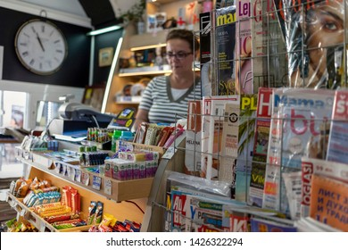 Belgrade, Serbia, June 16th 2019: Magazine stand and seller in a tobacco shop