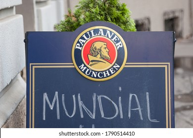 BELGRADE, SERBIA - JUNE 17, 2018: Paulaner Beer logo in front of the terrace of a Serbian bar advertising for the football world cup. Paulaner Bier is one of the symbols and main beers of Munich
