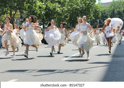 BELGRADE, SERBIA - JUNE 19: Traditional wedding dress race on the streets of Belgrade. Winner wins cash prize - June 19, 2011 Belgrade, Serbia.