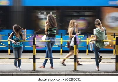 Belgrade, Serbia - June 21, 2017: Four young women - teenage girls waiting at bus stop