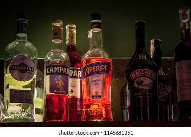 BELGRADE, SERBIA - JUNE 23, 2018:  Aperol Spritz Bottle surrounded by other alcoholic bottles on the shelf of a bar. Aperol Spritz is a wine-based cocktail commonly served as an aperitif in Northeast