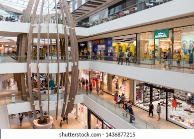Belgrade, Serbia - June 23, 2019: Newly opened Ada Mall shopping center has stores of many worldwide known brands and food court on four floors. Interior view.