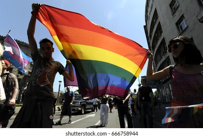 BELGRADE, SERBIA - JUNE 24, 2017: Protesters march with large LGBT rights rainbow flag on June 24 in Belgrade