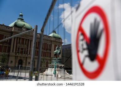 BELGRADE, SERBIA - JUNE 24, 2019: View of National museum in Belgrade, Serbia through the wire and forbidden entrance sign due to reconstruction of Republic square