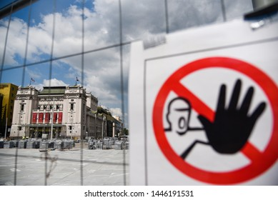 BELGRADE, SERBIA - JUNE 24, 2019: View of National theatre in Belgrade, Serbia through the wire and forbidden entrance sign due to reconstruction of Republic square