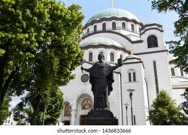 BELGRADE, SERBIA - June 4, 2019: Statue of Saint Sava, a highly prominent religious figure in Serbian history in front of the Church of Saint Sava
