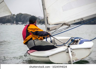 Belgrade, Serbia - Man in the Finn-Class sailboat participates in one of the match race regattas on the Sava River