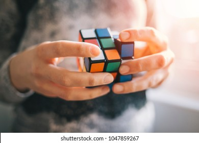 BELGRADE, SERBIA - MARCH 08, 2018: Close up of woman holding Rubik's cube. Rubik's cube is the most famous puzzle cube in the World.
