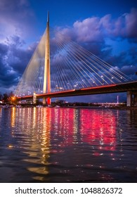 Belgrade, Serbia - March 12th 2018., New Ada bridge across the river Sava in Belgrade, Serbia during the beautiful golden sunset hour light and water reflections, wide angle lens used for perspective