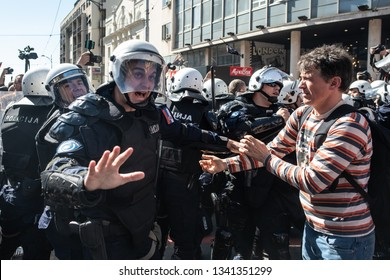 Belgrade, Serbia - March 17, 2019: Anti-government protests near the Presidency of Serbia where President Vucic was addressing nation. Protestors managed to break the cordon in one moment.